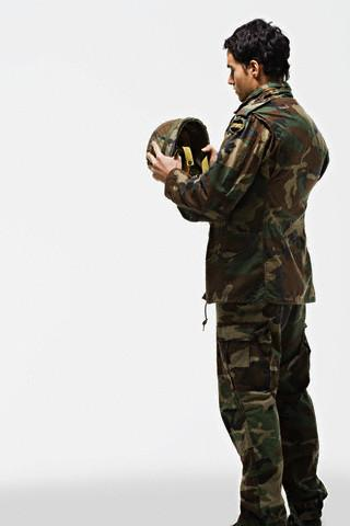Soldier putting on helmet